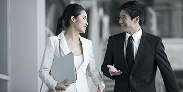 Asian business people talking outside (2-1) 365x183